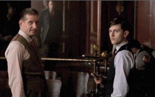 Mickey Doyle gives Joe Harper a gun